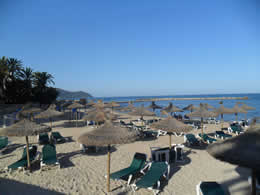cala bona beach with sunbeds and parasols