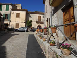 valldemossa street with colourful plant pots